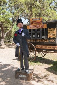 "Historical intrepreter Ross Nelson as ""Professor Thaddeus Schmidlap"", resident snake-oil salesman at the Enchanted Springs Ranch and Old West theme park, Boerne, Texas. (Source: Wikipedia, rtrvd. 2016-05-11)"