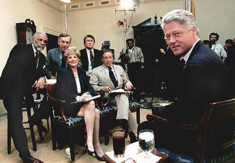 "Then-President Bill Clinton takes a break while being interviewed by the cast of ""60 Minutes"" on Dec. 8, 1995 at the White House. Standing from left are; Ed Bradley, Morley Safer, and Steve Kroft. Seated are Lesley Stahl and Mike Wallace. CREDIT: AP Photo/The White House"