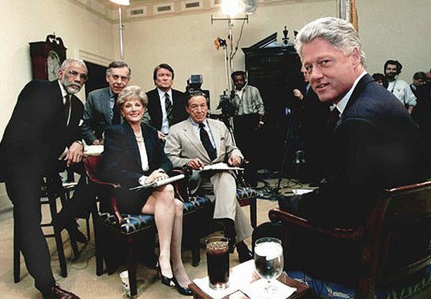 "Then-President Bill Clinton takes a break while being interviewed by the cast of ""60 Minutes"" on Dec. 8, 1995 at the White House. Standing from left are; Ed Bradley, Morley Safer, and Steve Kroft. Seated are Lesley Stahl and Mike Wallace. (CREDIT: AP Photo/The White House)"
