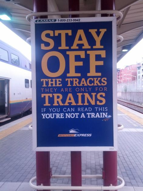 "Pay-off line; ""Stay of the tracks. They are only for trains. If you can read this, you are not a train."""